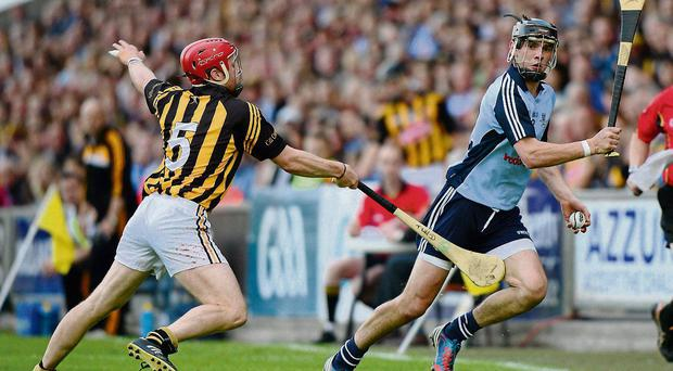 Danny Sutcliffe takes on Tommy Walsh during Dublin's victory over Kilkenny