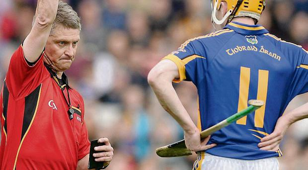 Lar Corbett is sent off in the league final, during which, he also fractured his ribs