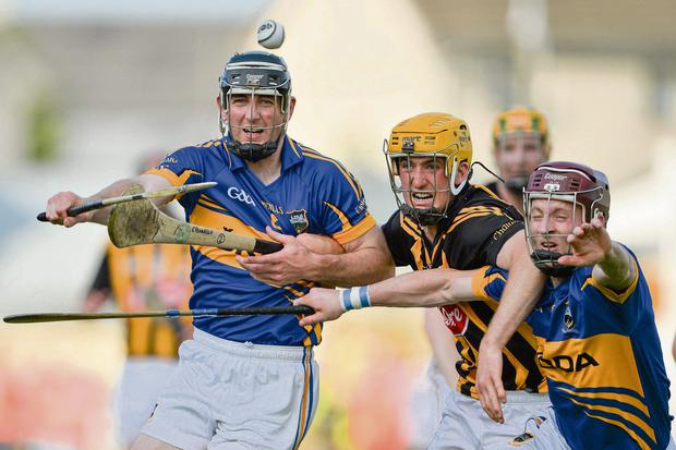 Colin Fennelly, Conor O'Mahony and Paddy Stapleton battle for the ball in Nowlan Park.