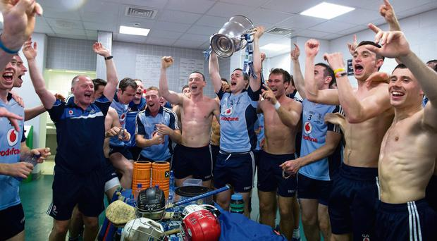 Man of the match Paul Ryan holds up the Bob O'Keeffe Cup as the Dublin hurlers celebrate their Leinster SHC final victory in the Croke Park dressing-rooms
