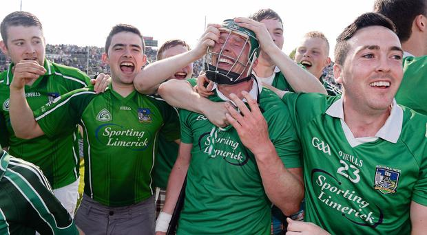 Limerick supporters celebrate with corner-back Stephen Walsh after beating Tipperary in the Munster SHC semi-final last month