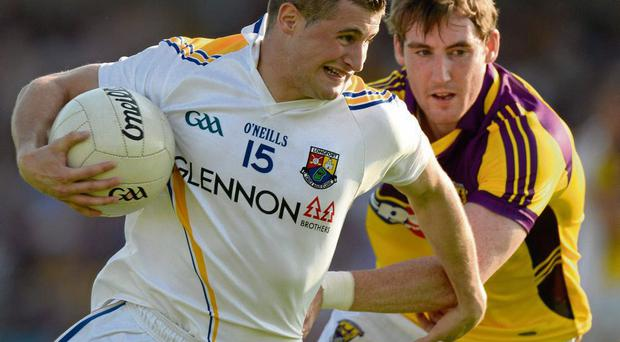 Longford's JJ Matthews and Robert Tierney of Wexford.