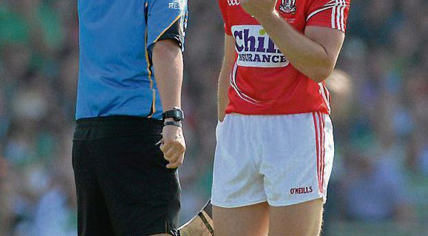 Cork's Patrick Horgan is shown a straight red card by James McGrath
