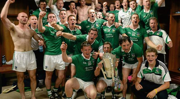 The Limerick squad celebrated with the cup in the Gaelic Grounds dressing room