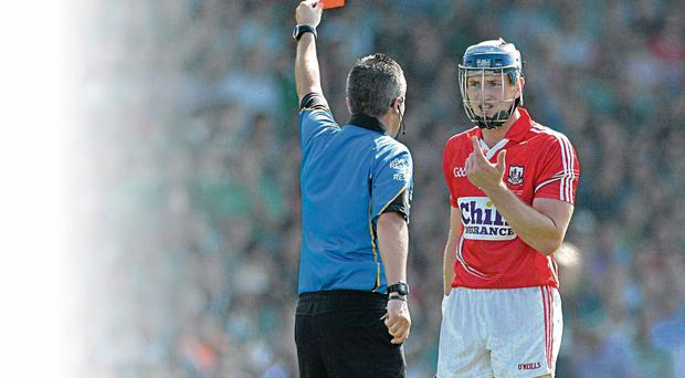 Cork's Patrick Horgan is shown a red card by referee James McGrath during the Munster SHC final against Limerick in the Gaelic Grounds
