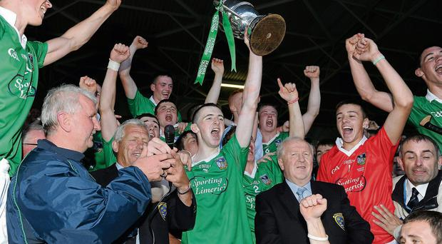 Limerick captain Richard English lifts the cup after winning the Munster MHC final replay