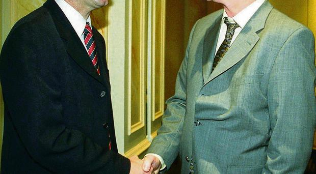 Barry-Murphy and Cody shaking hands at a lunch on the day after the 1999 All-Ireland hurling final which was won by Cork