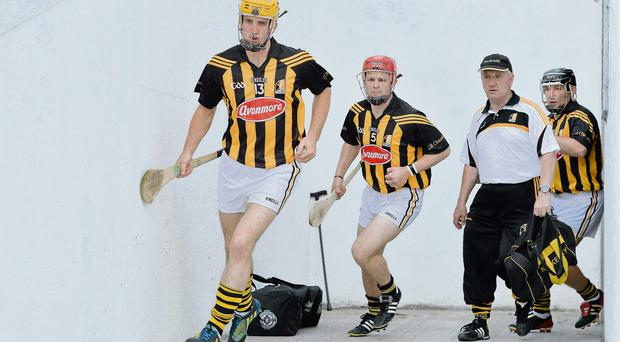Kilkenny captain Colin Fennelly leads his side out, followed by team-mates Tommy Walsh and Richie Hogan and kit man Rackard Cody