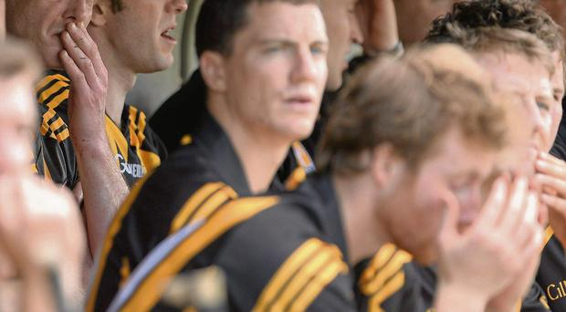 Kilkenny's Henry Shefflin (back left) cuts a disconsolate figure on the substitutes' bench after being sent off in their defeat to Cork in Semple Stadium
