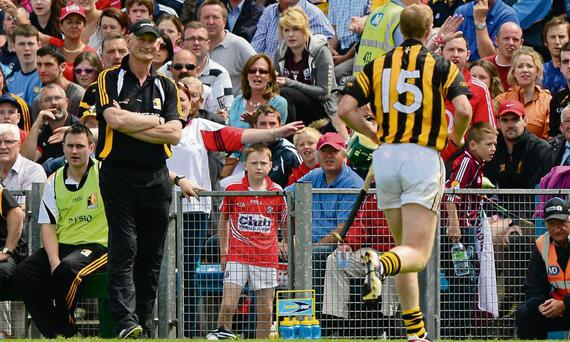Henry Shefflin goes past Kilkenny manger Brian Cody after being sent off in Semple Stadium against Cork