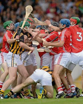 Cork and Kilkenny players scuffle during their quarter-final clash in Semple Stadium