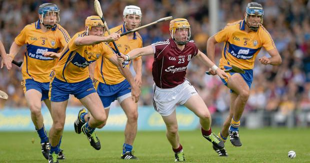 Galway's David Glennon is all alone against Clare quartet David McInerney, Cian Dillon, Patrick O'Connor and Brendan Bugler