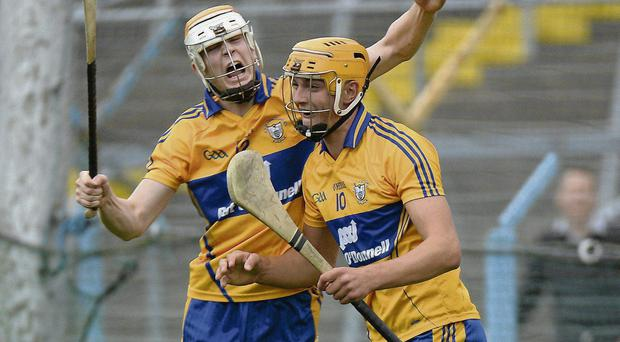 Peter Duggan, Clare, celebrates after scoring his sdie's first goal against Tipperary with team-mate Aaron Cunningham, left
