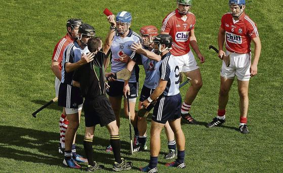 Ryan O'Dwyer (red helmet) reacts after being shown a red card last Sunday in the latest in a number of controversial dismissals this summer