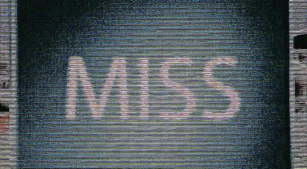 A 'miss' is displayed on the big screen following a decision made as a result of Hawk-Eye