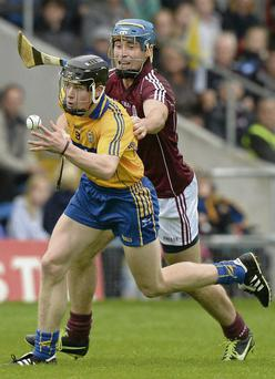 Clare midfielder Tony Kelly gets away from Conor Cooney of Galway during Saturday's Bord Gais Energy All-Ireland U-21 semi-final as Banner's U21s joined their seniors in the All-Ireland final