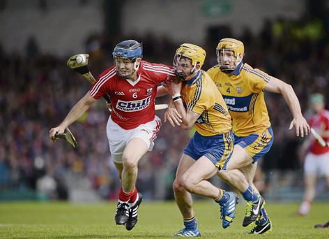 Cork's Christopher Joyce attempts to get away from Clare duo Colm Galvin and Cian Dillon in their Munster SHC clash