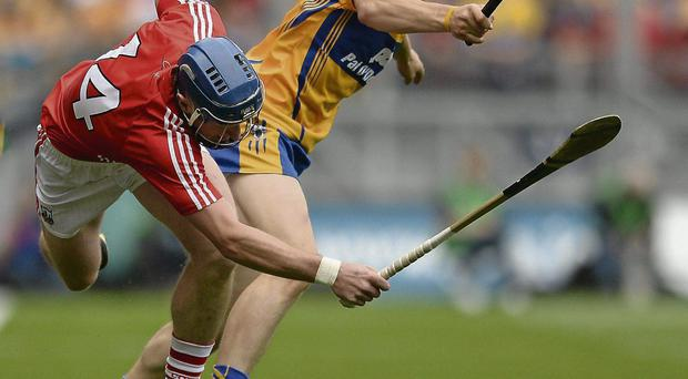 Cork's Patrick Horgan comes out second-best in this tussle with David McInerney