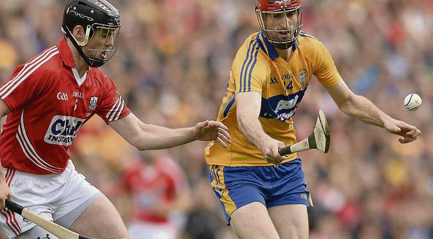 Darach Honan, Clare, in action against Shane O'Neill, Cork - he has retained his place for the replay