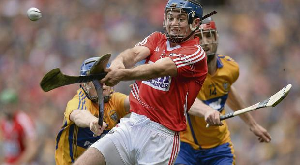 Cork's Christopher Joyce is challenged by Clare's Luke O'Farrell (L) during last Sunday's dramatic hurling final