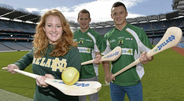 Notre Dame graduate Marissa Gaskill with Wexford hurler Lee Chin, right, and Kilkenny's Jackie Tyrrell at the launch of the Super Hurling 11s which will take place at Notre Dame University on October 19 with the support of Aer Lingus