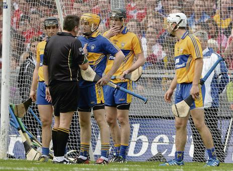 Referee Brian Gavin speaks to Clare goalkeeper Patrick Kelly before Anthony Nash scored Cork's second goal from a free during the All-Ireland final