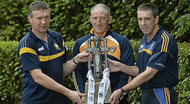 Antrim boss Kevin Ryan with Clare's Donal Moloney, left, and Gerry O'Connor