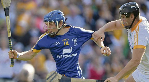 Clare's Shane O'Donnell tries to get away from Matthew Donnelly in Semple Stadium yesterday. Photo Brendan Moran
