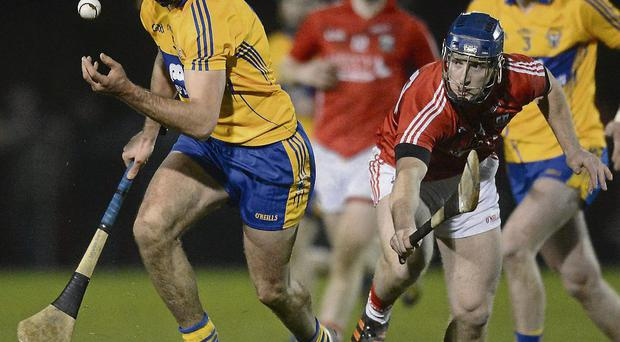 Clare's Brendan Bulger in action against Cork's Patrick Horgan in the Waterford Crystal Cup in their first meeting