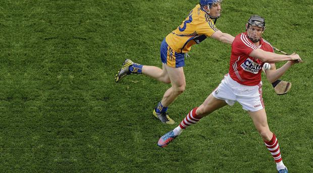 Cork's Stephen White in action against Podge Collins of Clare during the drawn All-Ireland final at Croke Park