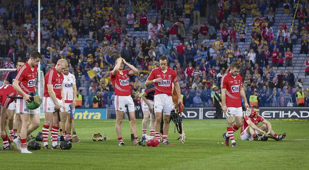Dejected Cork players after the game. Photo: David Conachy