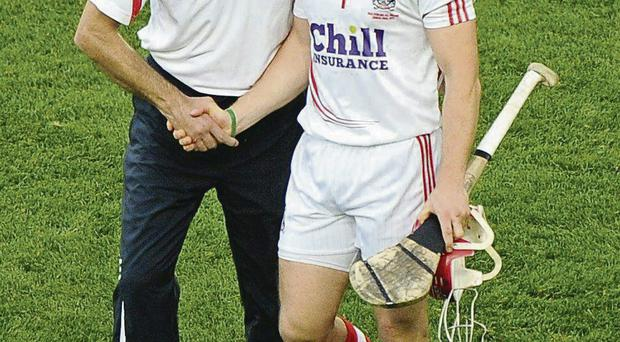 Cork manager Jimmy Barry-Murphy consoles goalkeeper Anthony Nash after the game