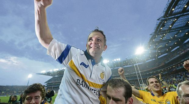 Clare manager Davy Fitzgerald is held aloft by some of his players after beating Cork
