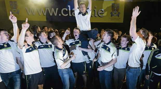 Clare's Shane O'Donnell lifts the Liam McCarthy Cup during the homecoming celebrations for the All Ireland SHC champions in Ennis last night