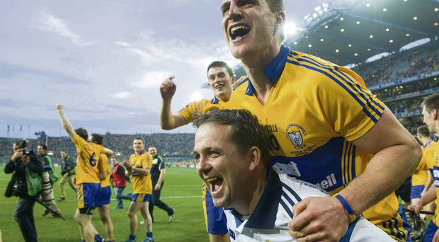 Clare manager Davy Fitzgerald celebrates with John Conlon at the end of the game