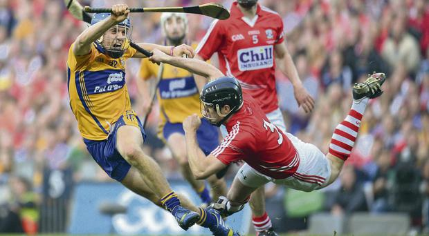 Shane O'Donnell of Clare fends off the attentions of Cork's Shane O'Neill during Saturday's final