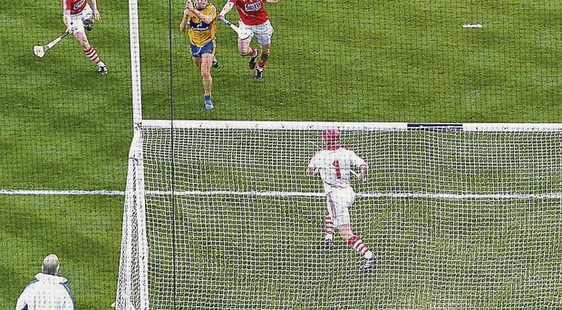 Shane O'Donnell, Clare, shoots to score his side's third goal