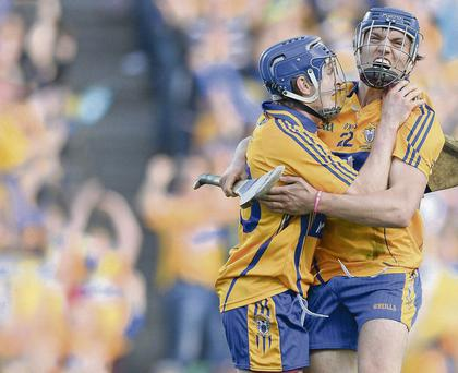 Shane O'Donnell, Clare, celebrates after scoring his side's second goal with team-mate Padraic Collins, left
