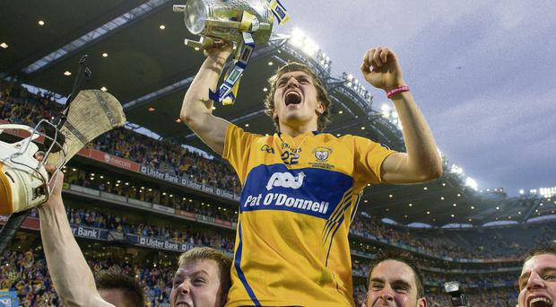 Shane O'Donnell, main, is lifted shoulder-high by his team-mates after Clare's All-Ireland final victory