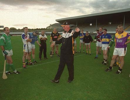 Kilkenny manager Brian Cody talks to his players during a training session in preparation for the 2002 All-Hurling final