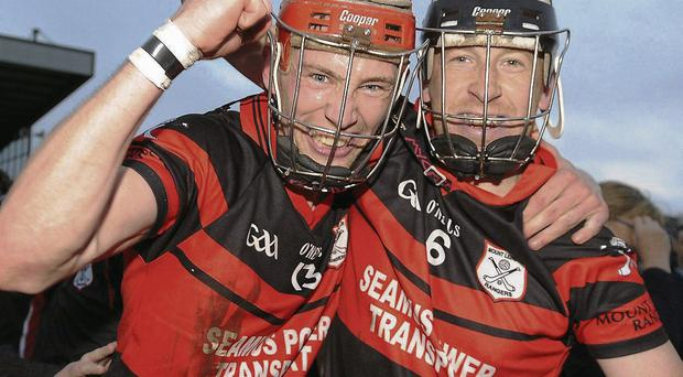 Mount Leinster Rangers' Denis Murphy, left, and Richard Coady celebrate after the game.