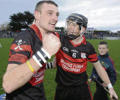 Mount Leinster's Gary Kelly (L) and Richard Coady celebrate after their victory Ballyboden St Enda's on Sunday PAT MURPHY / SPORTSFILE