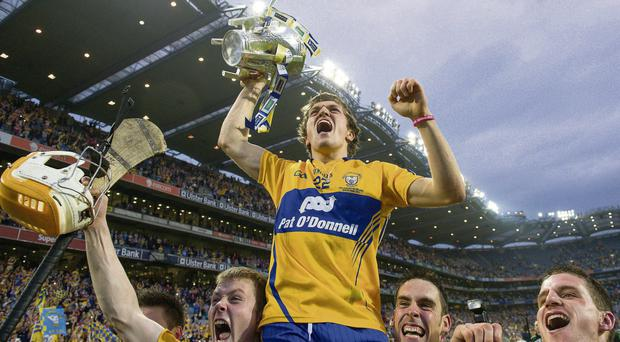 Shane O'Donnell is lifted by his Clare team-mates as they celebrate with the Liam MacCarthy Cup after beating Cork