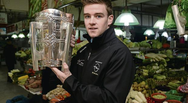 Hurler of the Year Tony Kelly with the Liam MacCarthy Cup at a local market during the Allstars trip to Shanghai RAY McMANUS/SPORTSFILE