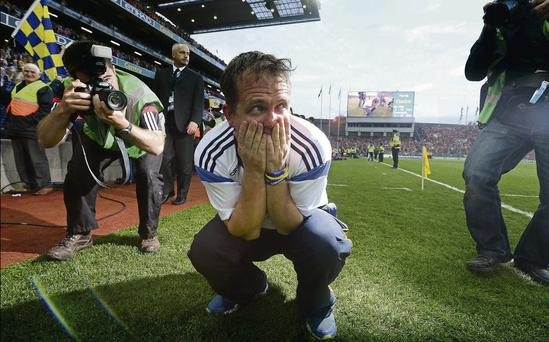 Davy Fitzgerald tries to grab a moment to himself after Clare's All-Ireland triumph.