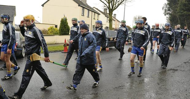Davy Fitzgerald and the Clare team make their way back towards Semple Stadium for their league clash with Tipperary
