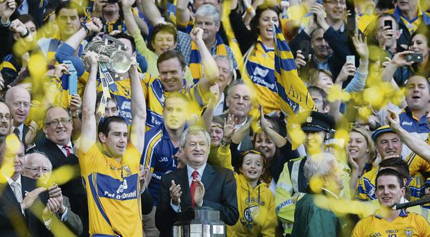 Clare captain Patrick Donnellan collects the Liam MacCarthy cup after defeating Cork in the All-Ireland final replay