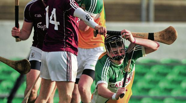 Offaly's Dan Kelleher in action against Niall Healy of Galway in the Walsh Cup at O'Connor Park Barry Cregg/SPORTSFILE