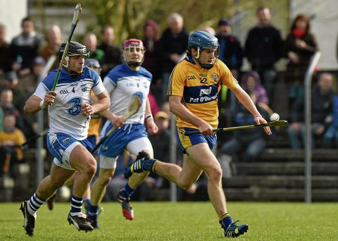 Clare's Shane O'Donnell breaks free from Noel Connors of Waterford before blasting to the net