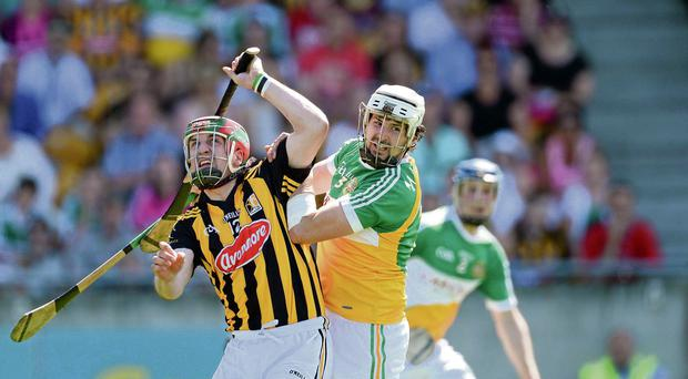 Kilkenny's Eoin Larkin and David Kenny of Offaly battle for possession